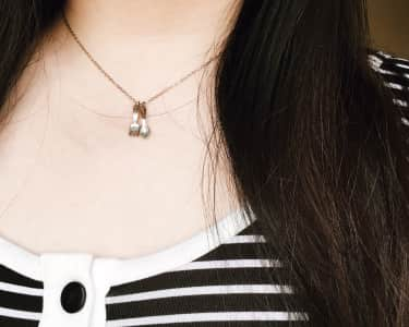 Girl wearing fork and spoon necklace
