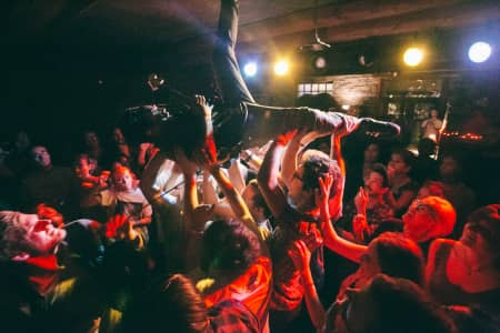 Ricky, the guitarist of Foxing, crowd surfing.