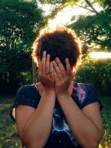 My girlfriend covering her face.