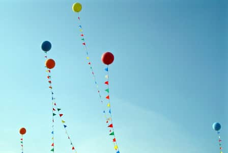 Colorful ballons floating in a blue sky