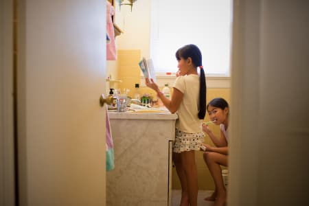 Book worm girls in bathroom