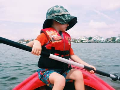 Kid learning to paddle