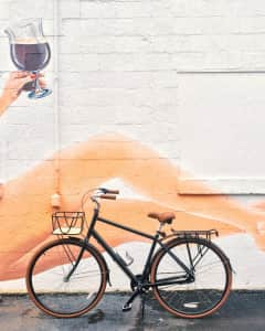 Vintage bicycle in front of mural
