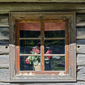 Old log house's window in Estonia countryside