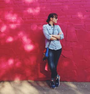in the background a brick wall painted in pink