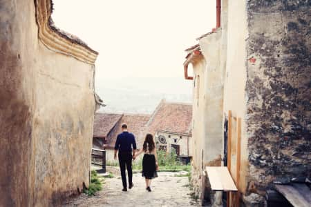 Romantic couple walking in old city holding hands