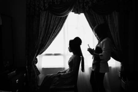 Silhouette of brides getting ready.