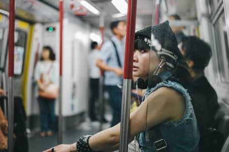 Punk woman in train, Hong Kong