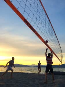 Oceanside beach volleyball as the sun sets on Jericho Beach.