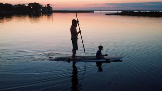 Father and son on stand up paddle board