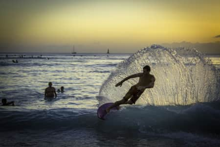 Surfer carving waves in Hawaii
