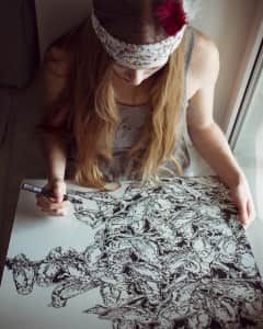 Girl is drawing freehand