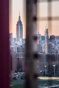 A peek at Empire State Building from Williamsburg Bridge
