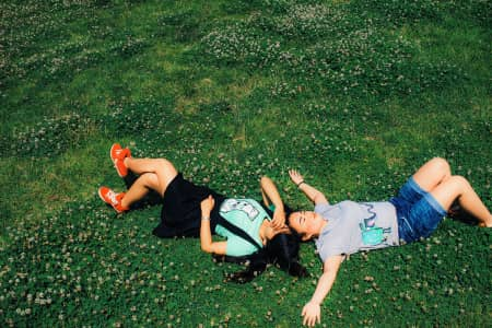 Happy people lying on the grass.