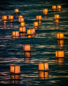Floating lanterns- candle lights on water, Memorial Day Hawaii