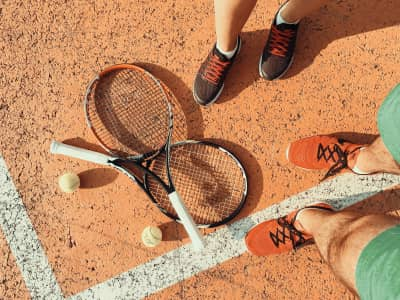 Tennis Players Preparing For A Sports Game On Court