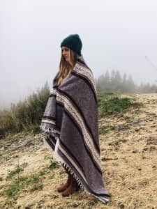 Girl on a mountain with fog
