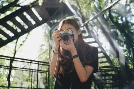 Asian hipster woman taking photo