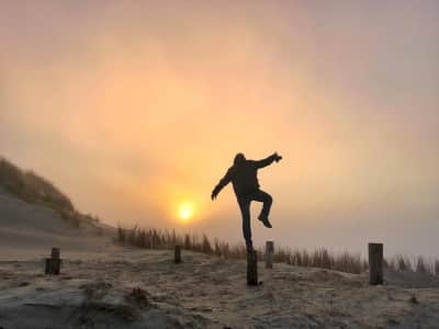 Magical moment at the beach in the foggy sunset