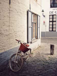 A bicycle in front of the house