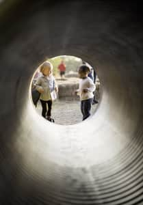 Kids playing in a tunnel