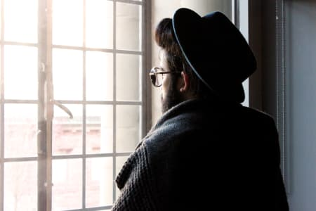 man at looking at a window