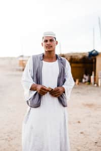Friendly roadside campfire wood merchant in rural Saudi Arabia. Taken during one of my travels.