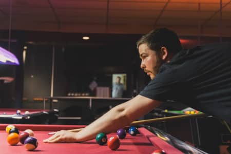 Man playing Pool.