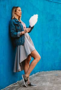 Woman eating cotton candy