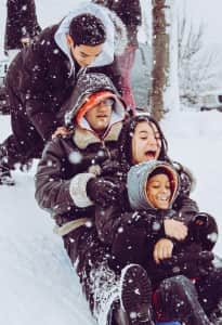 Snow day sled riding