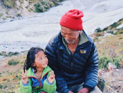 Grand father and little girl laughing in Nepal