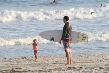 Little toddler knows whose the boss as she instructs her surfer dad where to go -nominated