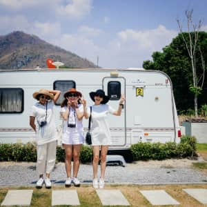 Girls in line in front of camper van