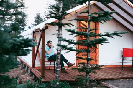 Young stylish man cabin camping