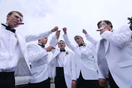 "2015 Sanford high school graduates start a new tradition ""The Senior cigar smoke"" at the Sanford school in Hockessin, Delaware."