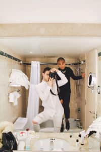 Interracial couple in bathroom - taking photos in the washroom, selfie, in a hotel room, all dressed up, handsome men, fashionable men, black and white