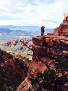 couple kissing on cliff in Sedona
