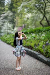 Girl looking through binocular
