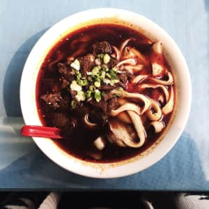 Spicy beef hand-shaved noodle soup