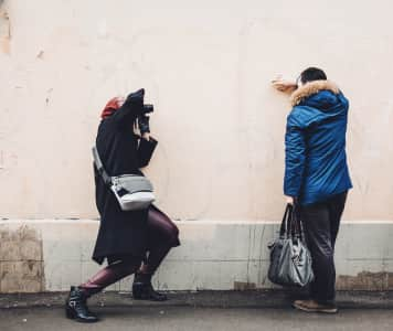 a model and a photographer snapping photos