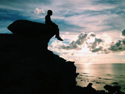 A silhouette of a boy with a view to remember