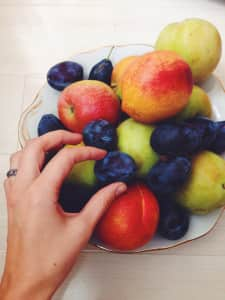 seasonal fruit, apples, peaches, nectarines, plums-the hand reaches to take