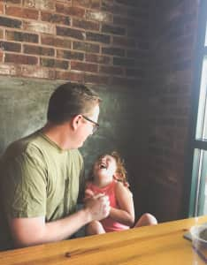 Father and Daughter waiting for dinner at Pinthouse Pizza in Austin, Texas