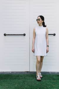 Woman standing in front of white door