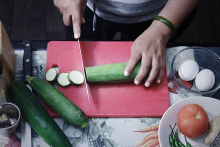 Cutting Zuccini and preparing for vegetarian dish for dinner