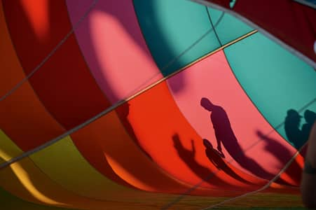 Looking thru a hot air balloon as they blow it up.  Adirondack balloon festival  NY