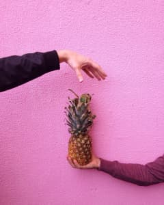 Hand holding pineapple