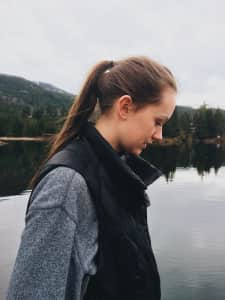 side profile shot of girl by lakeside