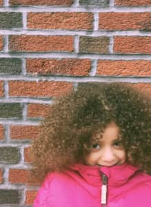 Portrait - kid on brick wall