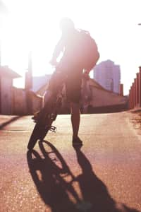Bike rider in the sunset lights